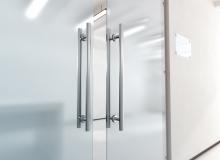Blank glass door with metal handles mock up,